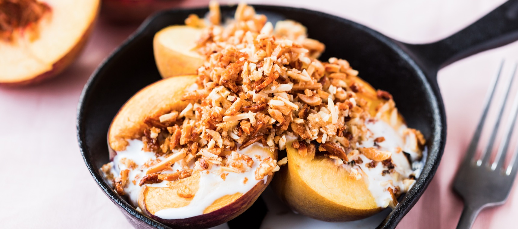 Grilled Peaches with Coconut Cream and Almond Crumble