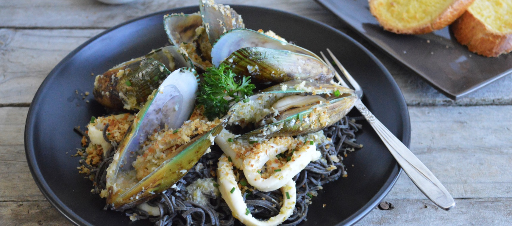 Mussels and Calamari with Black Bean Spaghetti
