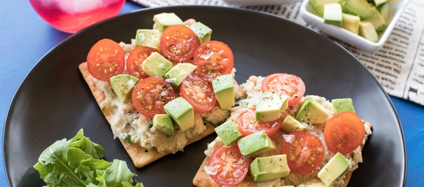 Smashed White Beans, Avocado and Tomatoes on Crackers