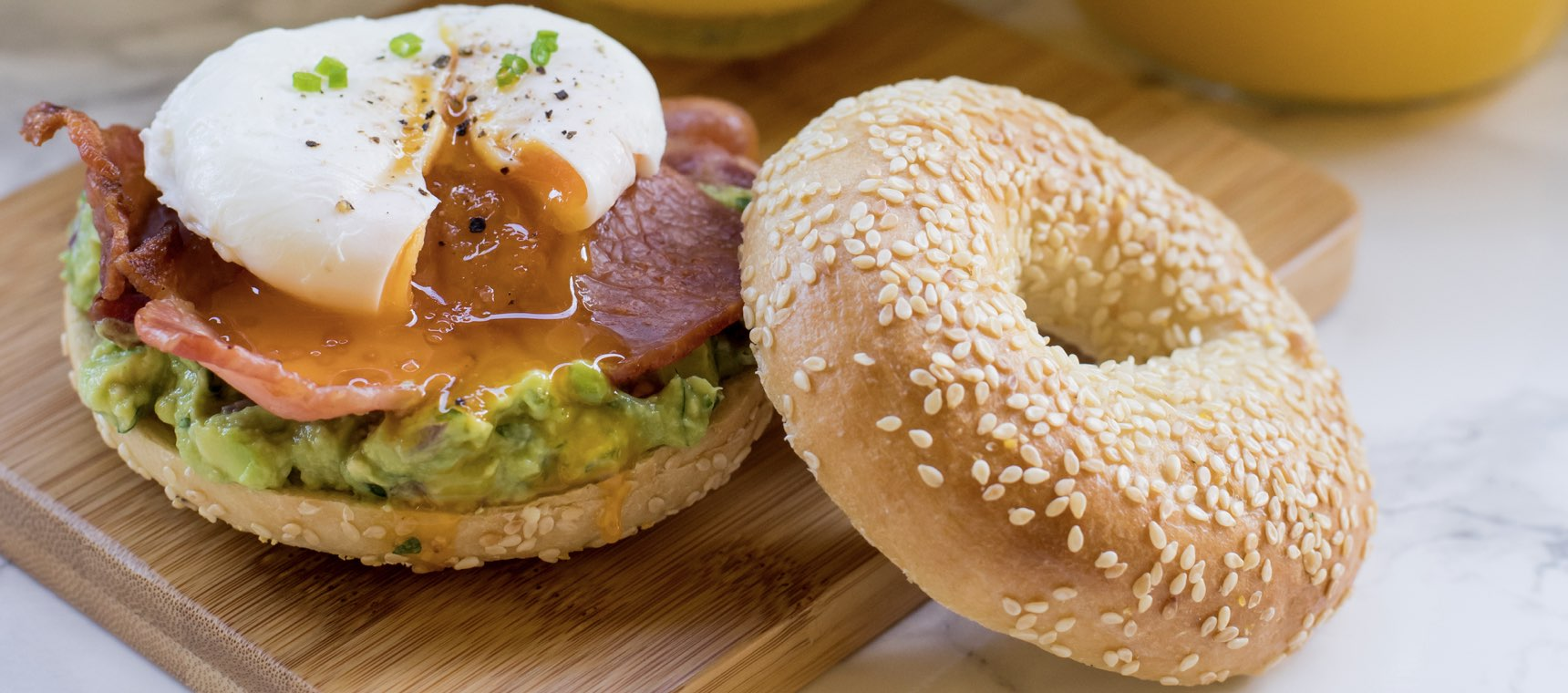 Guacamole Bagels with Bacon and Poached Eggs